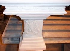 Pedestal of bench depicting Phoenix